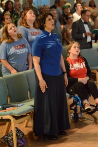 Interfaith Vigil at UUCFM.  Katie Romano Griffin Singing With  Youth.  Photo by Walter Peterson.