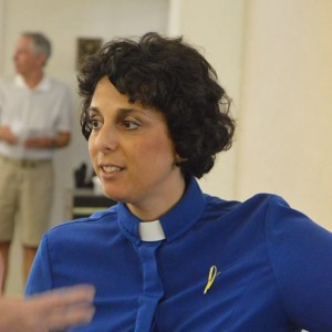 Interfaith Vigil at UUCFM.  Katie Romano Griffin Giving Directions. Photo by Walter Peterson.